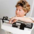 woman disappointed on scales - Find the diet to keep the weight off - diet plan - diet & wellbeing - allaboutyou.com