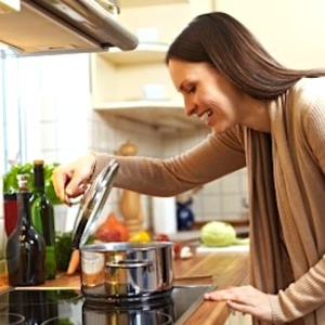 123 woman checking pot on stove - 200+ delicious diet recipes - Diet & wellbeing - allaboutyou.com